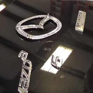 What is the easiest way to bond automotive emblems