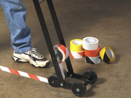 Floor marking with applicator - red white hazard warning tape