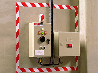 Red and white striped vinyl tape around electrical panel